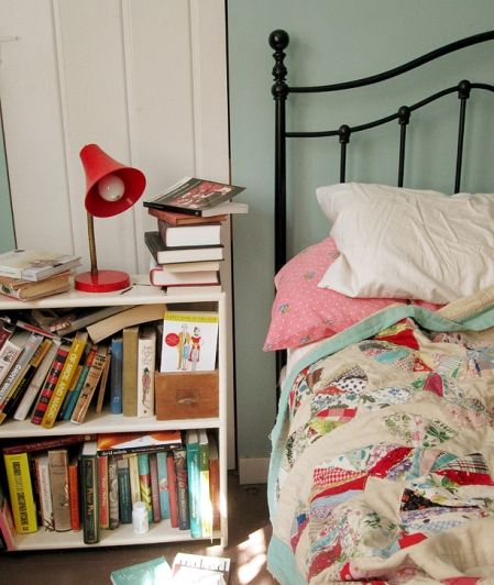 This is not my nightstand (click on photo for original link) but it could very well be. I have a similar pile and even have The Family Fang close by! Neat ;).